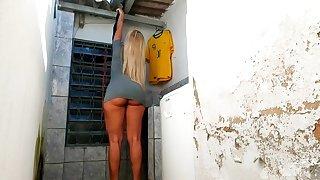 Sexy Brazilian blonde dressed in too short gray mini dress