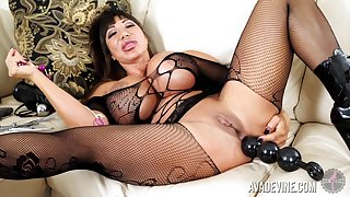 Tanned whorish MILF Ava Devine has some anal beads for her solo deport oneself