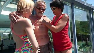 Outdoors FFM trine between an older couple and younger Darina