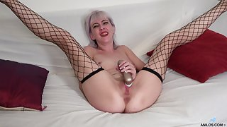 Amateur solo video of mature Sylvia S pleasuring will not hear of cravings